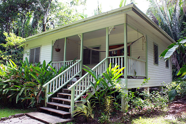 minutes contact seafront us in corozal walk the to growing supermarkets town is and belize fastest expat cottages coral community