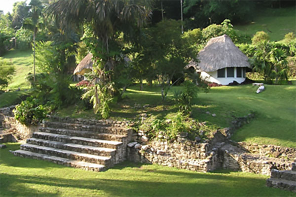 Cabanas set amongst partially excavated Mayan Ruins